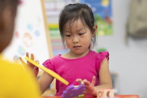 Preschool student focuses on building activity